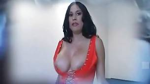 Gorgeous brunette is awesome red vinyl outfit is ready for some fun.