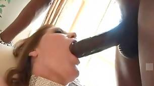 Curvaceous white slut moves up and down black stud`s shaft.