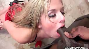 Sexy white babe skillfully works her mouth at big black cock.