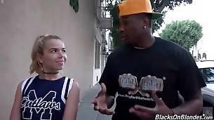 Black guy is seducing sweet blond cheerleader Alina West.